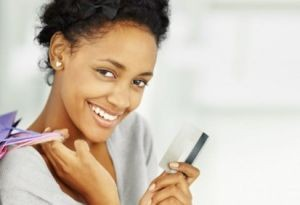 smiling-lady-holding-credit-card-468x282